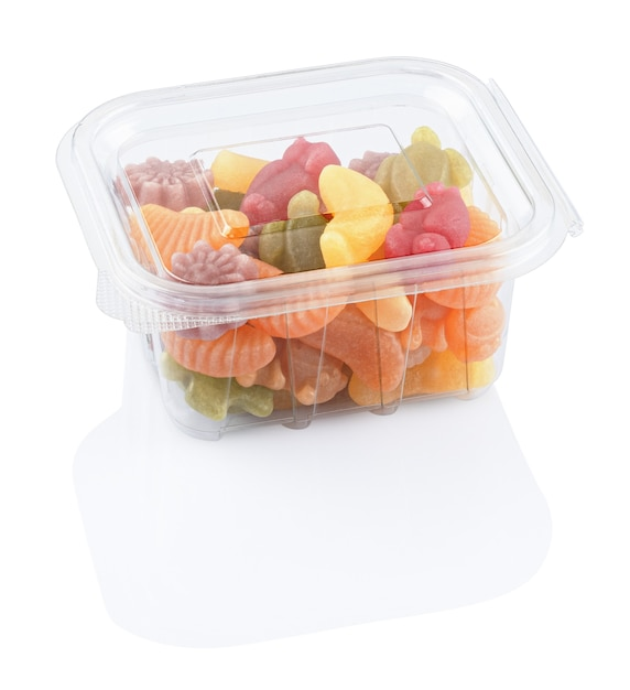 白い背景で隔離のプラスチック製のフードボックスのフルーツゼリーマーマレード Premium写真