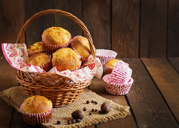 Fruit muffins with nutmeg and allspice on a wooden table Free Photo