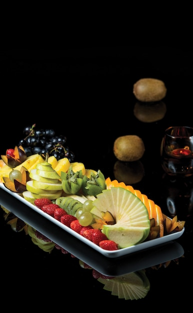 Fruit pltter with mixed summer tropical fruits. Free Photo