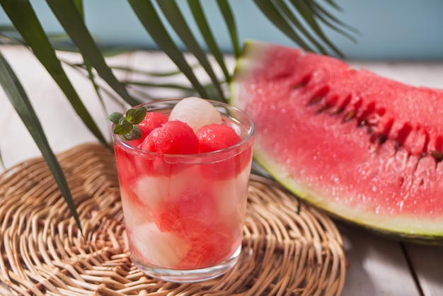 Fruit salad with melon and watermelon balls in glass Premium Photo