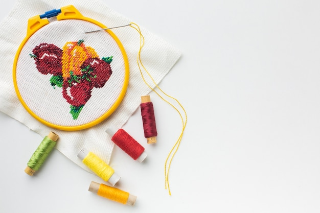 Fruit sewed design with sewing threads and copy space Free Photo
