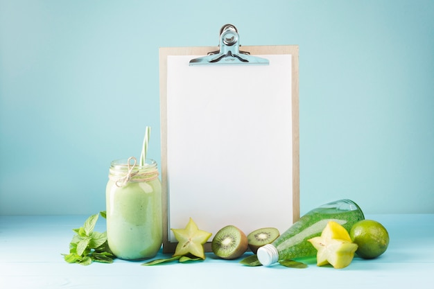 Fruit and smoothie with blank clipboard copyspace Free Photo