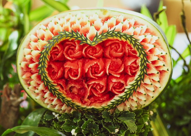 Fruit and vegetable carvings display thai fruit carving photo