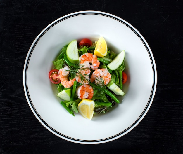 Fruit and vegetable salad with shrimp and asparagus Free Photo