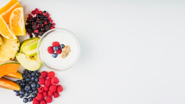 Fruits and berries near yogurt 23 2147717761