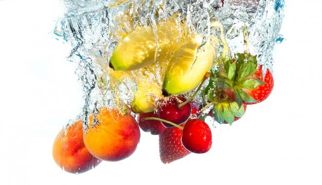 Fruits falling in water Premium Photo