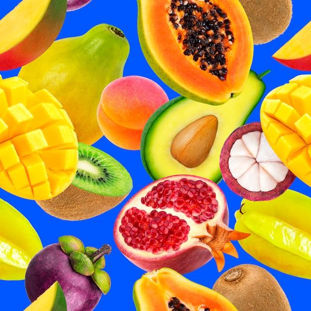 Фрукты бесшовный фон фон падение экзотических фруктов, изолированных на синем Premium Фотографии