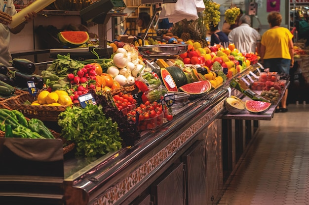 Fruits and vegetables on a counter in a market Premium Photo
