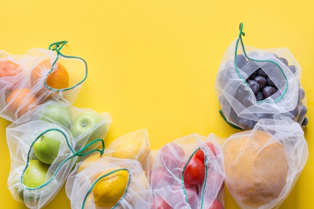 Fruits and vegetables in mesh bags. Premium Photo