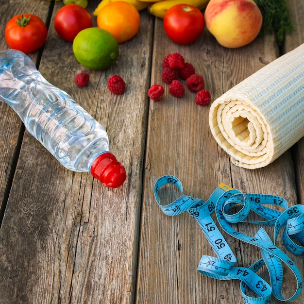 Fruits, vegetables, water, measurement tape and sports goods Premium Photo