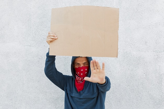 Frustrated activist hold cardboard Free Photo