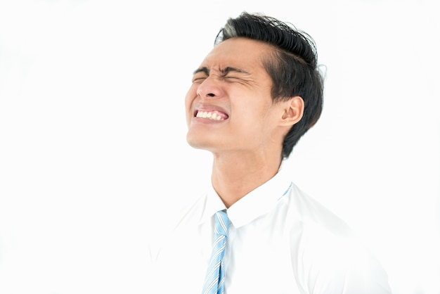 Frustrated asian businessman with closed eyes Free Photo