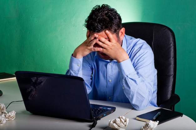 Frustrated businessman in his office Premium Photo