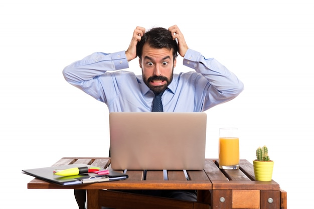 Frustrated businessman over white background Free Photo