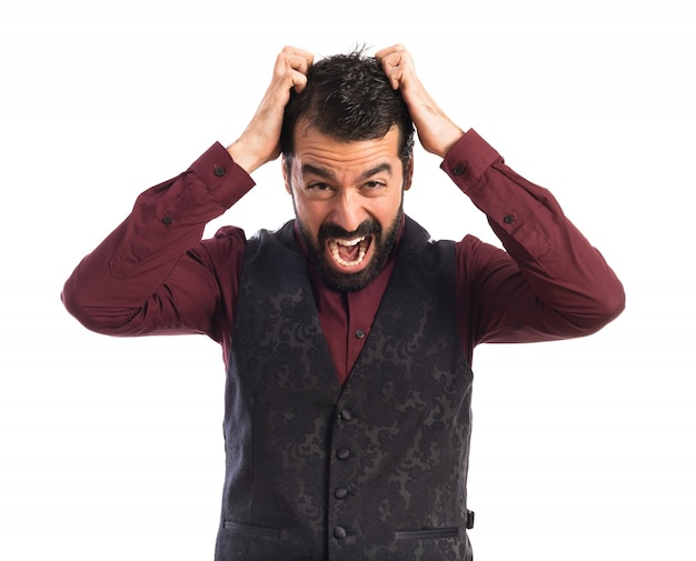 Frustrated man wearing waistcoat Free Photo