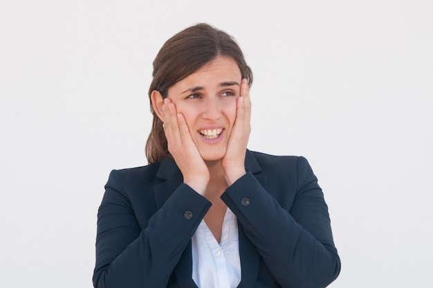 Frustrated office employee realizing her error Free Photo