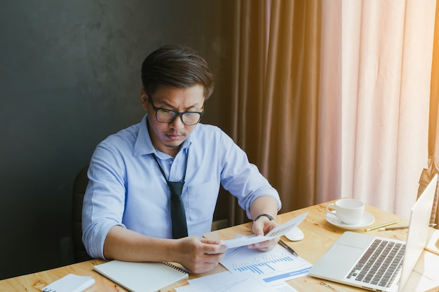 Frustrated stressed businessman in business result. Premium Photo