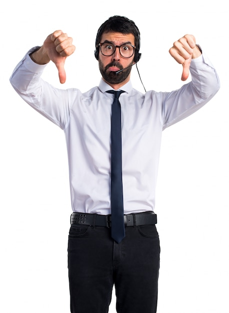 Frustrated telemarketer man Free Photo
