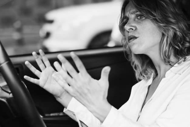 Frustrated woman stuck in a traffic Free Photo