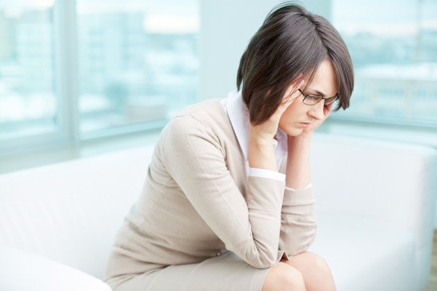 Frustrated woman with her work Free Photo