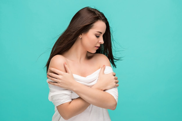 Frustrated young woman posing on blue Free Photo