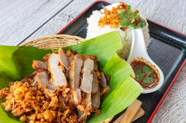Fry pork with sticky rice and spicy sauce, close-up Premium Photo