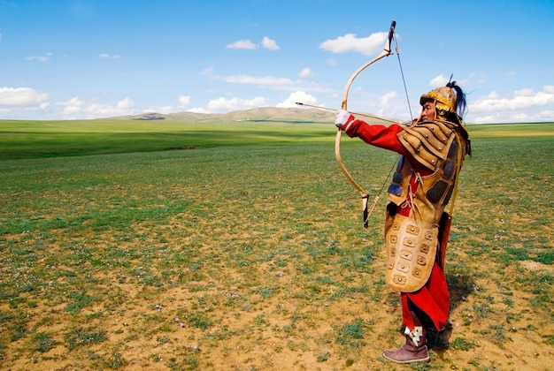 Full armored archer aiming to shoot. Premium Photo