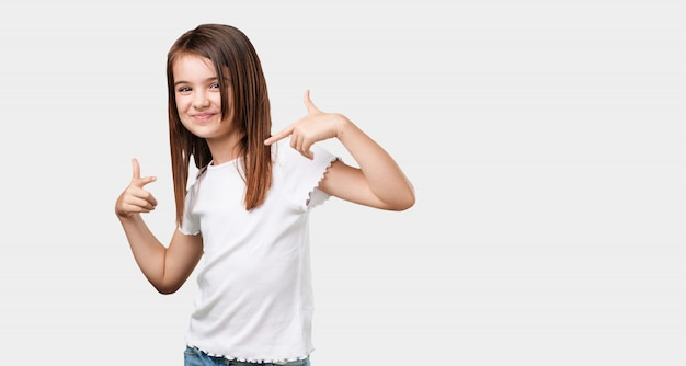 Full body little girl proud and confident, pointing fingers, example to follow Premium Photo