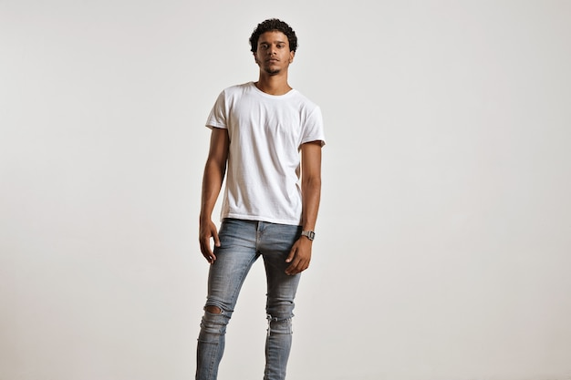 Full-body portrait of an athletic young male in ripped light blue jeans and blank white shortsleeve t-shirt Free Photo