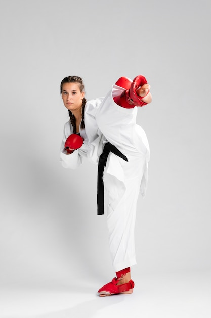 Full body of woman with box gloves on white background Free Photo