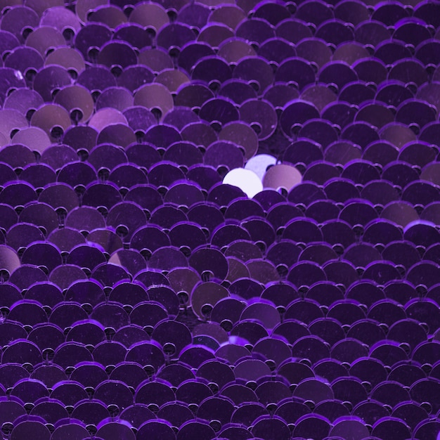 Full frame abstract background purple reflective sequins Free Photo