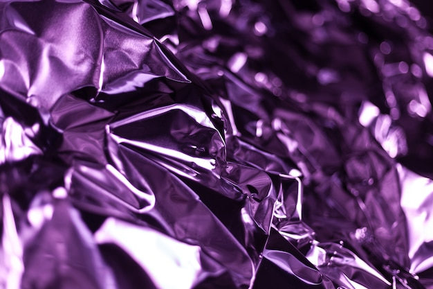 Full frame take of a sheet of crumpled magenta aluminum foil Premium Photo