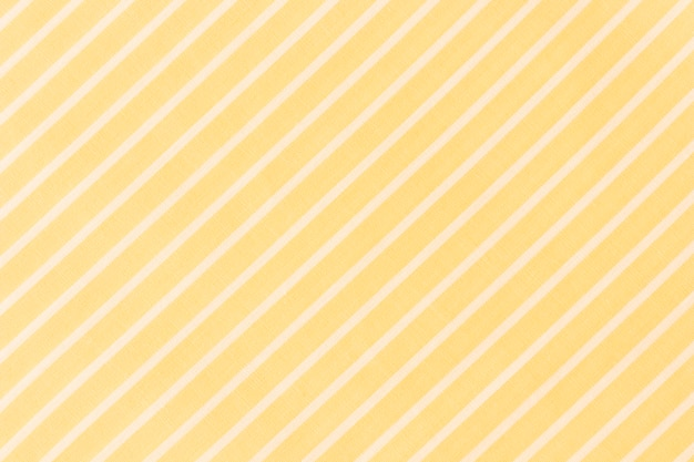 Full frame of white diagonal lines on yellow background Free Photo