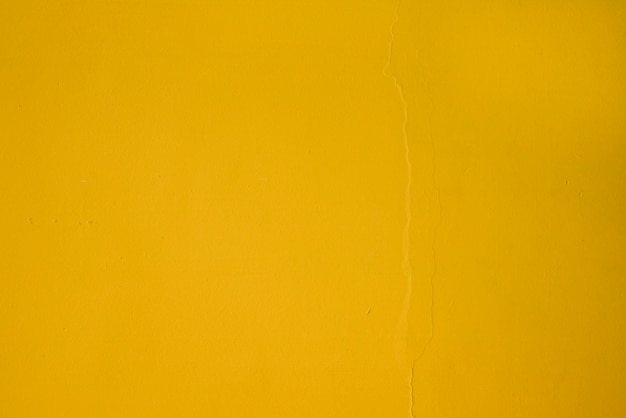 Full frame of yellow textured wall backdrop Free Photo