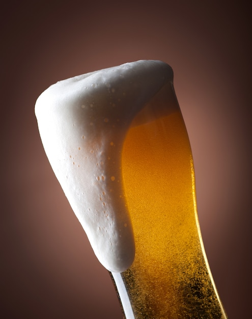 Full glass of beer on a brown Premium Photo