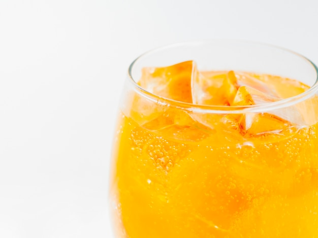 Full glass of orange soda with ice Free Photo