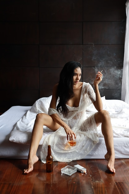 Sitting on Bed Lady in Nightie Long Dark Hair Holding Puppy Vintage Photo Colour Photo Lady in Negligee