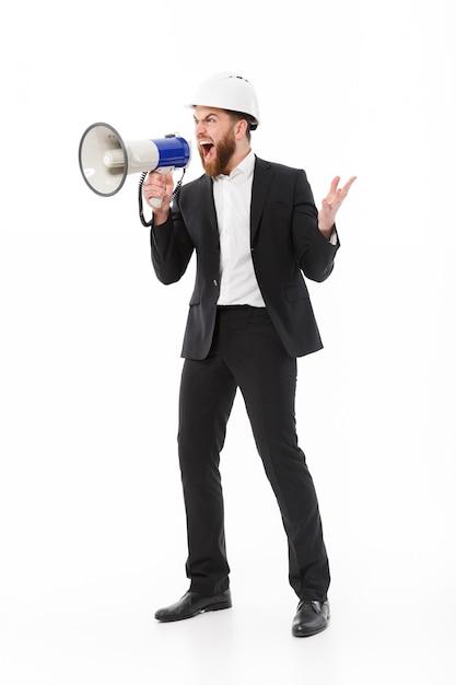 保護用のヘルメットで怒っているビジネスマンの完全な長さの画像 無料写真