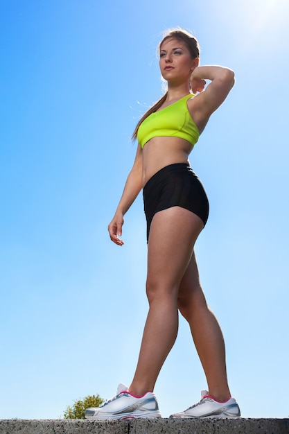 Full length portrait of caucasian young woman in fitness wear outdoors Free Photo