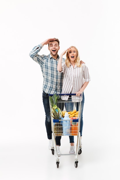 Full length portrait of a cheerful couple Free Photo