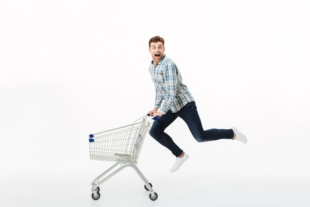 Full length portrait of a cheerful man jumping Free Photo