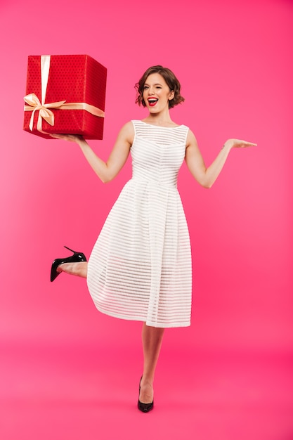 Full length portrait of a cheery girl Free Photo