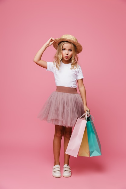 Full length portrait of a cute little girl in hat Free Photo