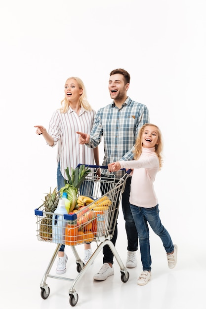 Full length portrait of an excited family Free Photo