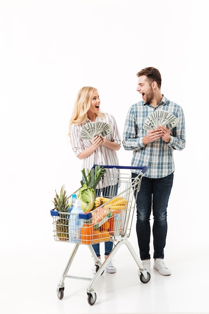 Full length portrait of a happy couple Free Photo