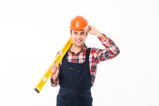 Full length portrait of a happy young male builder Free Photo