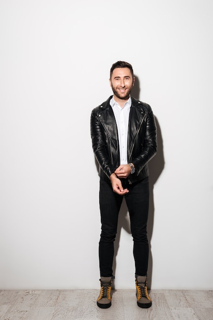 Full length portrait of a happy young man in jacket Free Photo