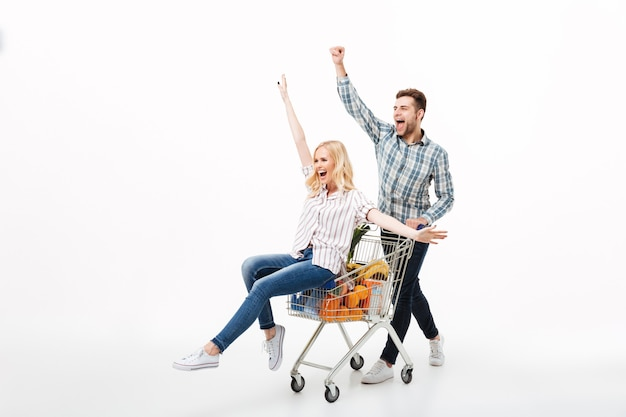 Full length portrait of a joyful couple having fun Free Photo