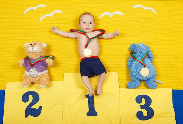 Full length portrait of a little child is standing on a place podium in first place. Premium Photo