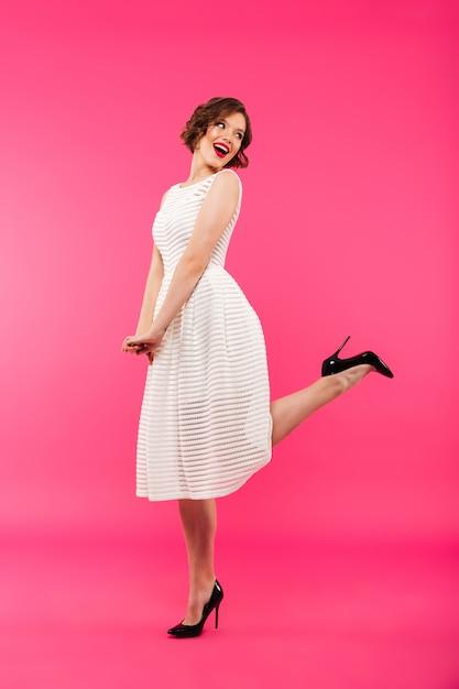 Full length portrait of a lovely girl dressed in dress Free Photo